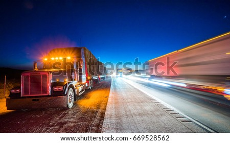 JUNE 29, 2017 : De Focus of  Dark Charcoal  FREIGHTLINER  FLD semi-trailer truck park on Interstate 5  Apple Valley California in the Morning of Extreme Low Light and heavy traffic on the freeway