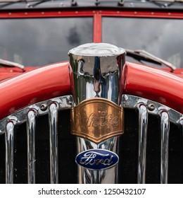 June 29, 2018: Many Glacier, United States: Red Jammer Grill on a vintage car used for touring Glacier National Park
