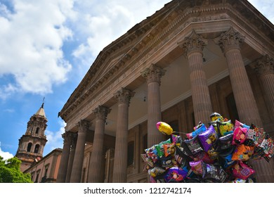 June 29, 2018. San Luis Potosí, Mexico. Exterior view of the Neo Classical architecture Teatro de La Paz with the Templo del Carmen bell tower in the background, located in Plaza del Carmen.