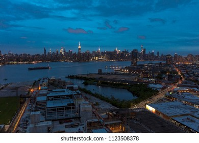 JUNE 3, 2018 - NEW YORK, NEW YORK, USA  - New York City and East River shows Chrysler Building on right and Empire State Building on Left, as seen from Queens