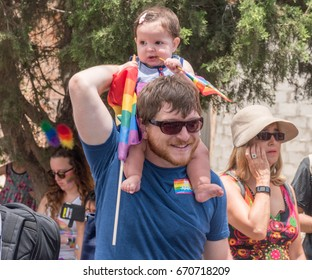 June 30, 2017. Gan HaEm is a public garden in Haifa-Israel. Pride parade and a holiday of love, organized by LGBT community with the participation of city authorities. Dad with a baby on his shoulders