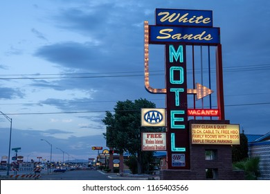 JUNE 30 2018 - ALAMOGORDO, NEW MEXICO: The White Sands motel sign lights up at dusk. The motel has a vintage, retro style signage, popular during the 1950s and 60s