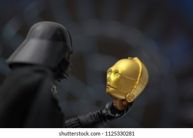 JUNE 30 2018: Conceptualizing a scene from Star Wars. Anakan Skywalker (Darth Vader) built the droid C-3PO as child on Tattooine. Here he encounters his droid  - Hasbro Black Series action figures