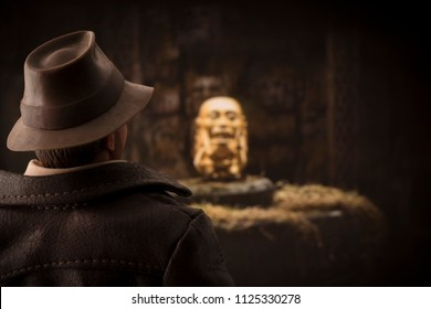 JUNE 30 2018: Recreation of a scene from Raiders of the Lost Ark where Indiana Jones steals the Fertility Idol - using Hasbro Action Figure