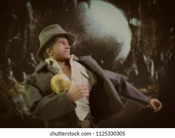 JUNE 30 2018: Recreation of a scene from Raiders of the Lost Ark where Indiana Jones steals the Fertility Idol and is chased by giant boulder - using Hasbro Action Figure