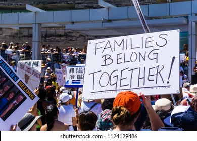 """June 30, 2018 San Jose / CA / USA - """"Families belong together"""" sign raised at the rally held in front of the City Hall, in downtown San Jose, a sanctuary city in south San Francisco bay area"""