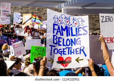 "June 30, 2018 San Jose / CA / USA - ""Families belong together"" sign raised at the rally held in front of the City Hall, in downtown San Jose, a sanctuary city in south San Francisco bay area"