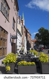 June 3rd 2017 Riga, Latvia - colorful buildings at the Skarnu eila/ street with  Saint John's Lutheran Church, St. Peter's church and street cafes in sunny spring day.