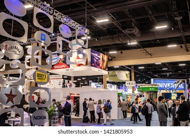 June 4, 2019, LAS VEGAS, NEVADA, USA, Attendees Enjoy the Beautiful and Intricately Designed Booths at the 2019 Licensing Expo Trade Show