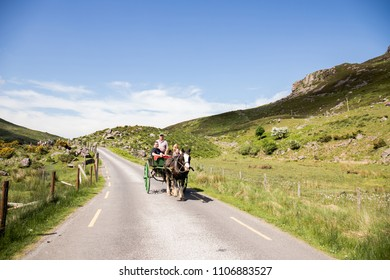 June 4th, 2018, Gap of Dunloe, Ireland - people enjoying a horse carriage ride next to Augher lake in county Kerry