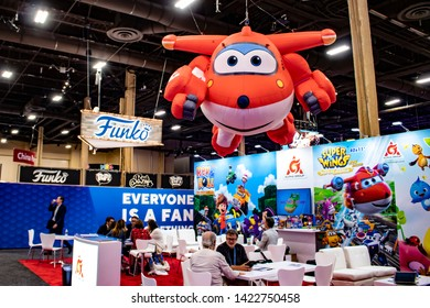 June 5, 2019, LAS VEGAS, NEVADA, USA, A Giant Inflatable Toy of the Jett Character from Super Wings Flies over the Alpha Group Booth at the 2019 Licensing Expo Trade Show