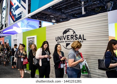 June 5, 2019, LAS VEGAS, NEVADA, USA, Attendees Line up to Get Free T-Shirts Made on-site at the Universal Brand Development Booth at the 2019 Licensing Expo Trade Show
