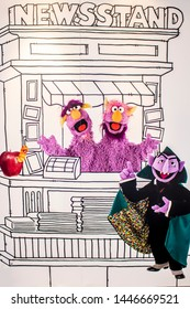 June 5, 2019, LAS VEGAS, NEVADA, USA, Minimalistic Artwork Featuring the Count, Two-Headed Monster, and Slimey the Worm Line the Sesame Workshop Booth at the 2019 Licensing Expo Trade Show