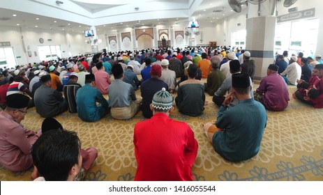 June 5, 2019 - Masjid Johan Setia, Malaysia. Muslims  were listening to preaching khutbah during eid day. Fisheye view. Description and keywords contain malay language.