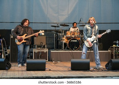 JUNE 5 - HUMENNE, SLOVAKIA: Miko Hladky (R), from music band Gladiator, performs at Humenne Amphitheatre on June 5, 2009 in Humenne, Slovakia.