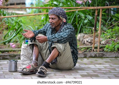 June 6, 2015: A man begs for alms on the street in Kasauli, northern India. Places like this mountain resort, that are frequented by tourists, also attracts these individuals hoping to cash in.