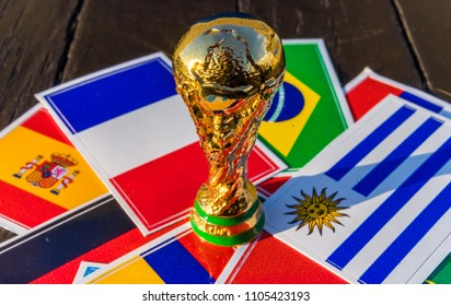 June 6, 2018 Moscow, Russia. FIFA World Cup trophy on the background of the flags of Brazil, Uruguay, France, Spain, Germany.