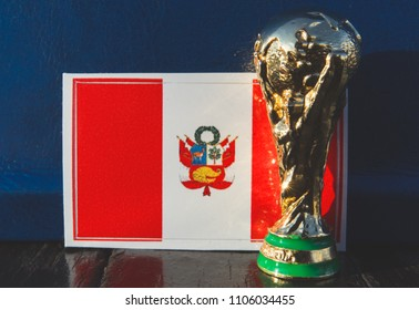 June 6, 2018 Moscow, Russia. Trophy of the FIFA World Cup on the background of the flag of Peru.