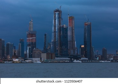 JUNE 6, 2018 - NEW YORK, NEW YORK, USA  - New construction midtown on the Hudson River with stormy clouds