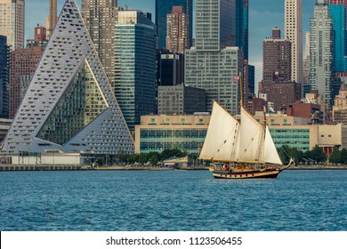 JUNE 6, 2018 - NEW YORK, NEW YORK, USA  - New York City and Hudson River features VIA 57 Building (Sale triangular shaped) and Manhattan Skyline with sailboat