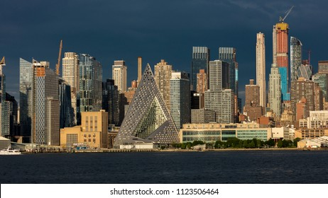 JUNE 6, 2018 - NEW YORK, NEW YORK, USA  - New York City and Hudson River features VIA 57 Building (Sale triangular shaped) and Manhattan Skyline