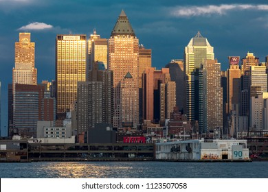 JUNE 6, 2018 - NEW YORK, NEW YORK, USA  - New York City and Hudson River at sunset