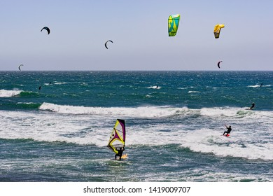 June 6, 2019 Davenport / CA / USA - People kite and wind surfing in the Pacific Ocean, near Santa Cruz, on a sunny and warm day