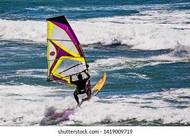 June 6, 2019 Davenport / CA / USA - Man windsurfing in the Pacific Ocean, near Santa Cruz, on a sunny and warm day