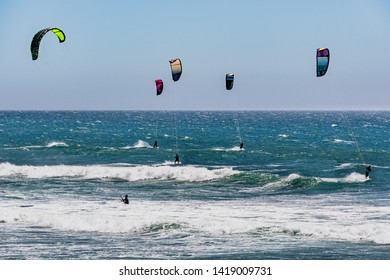 June 6, 2019 Davenport / CA / USA - People kite surfing in the Pacific Ocean, near Santa Cruz, on a sunny and warm day