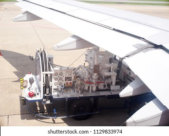 June 6,2018 Ground technician worker refill passenger airplane gasoline fuel from mobile station into an airplane wing under very warm condition on a sunny day at DONMUANG airport, BANGKOK, THAILAND