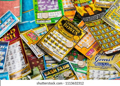 June 7. 2018. Detroit, Michigan, USA. Used Michigan Instant Scratch Games lottery Ticket Background. Selective focus.