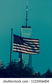 JUNE 7, 2018, JERSEY CItY, NEW JERSEY, USA - Flags fly over Freedom Tower,  Liberty Park, Jersey City, New Jersey