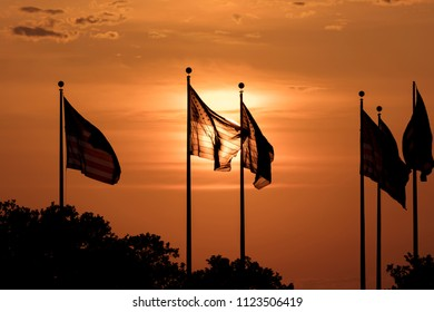 JUNE 7, 2018, Jersey City, New Jersey, USA - Group of US Flags at sunset Liberty State Park, New Jerssey