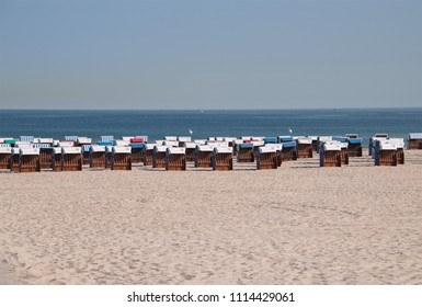 June 8, 2018 - Warnemunde, Germany: Rows of beach chair huts located on the beautiful white sand beaches of the northern Germany coastal city of Warnemunde before the tourists arrive on this date