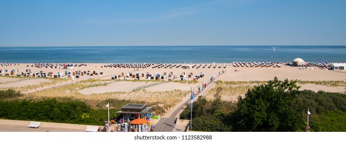 June 8, 2018 - Warnemunde, Germany: Drone panoramic view of beautiful beach in Warnemunde, Germany on Baltic Sea beach huts and bathers