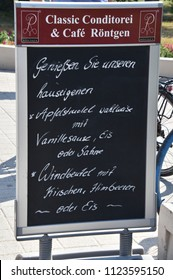 June 8, 2018 - Warnemunde, Germany: Menu sign for German cafe as seen in Warnemunde, Germany on this date