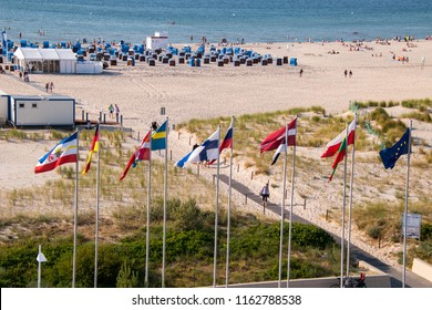 June 8, 2018 - Warnemunde, Germany: Drone view of beautiful beach in Warnemunde, Germany on Baltic Sea beach huts, bathers and flags