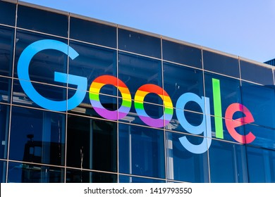 "June 8, 2019 Mountain View / CA / USA - Google logo displayed in the Company's campus in Silicon Valley; The ""double o's"" are decorated in rainbow colors in honor of LGBTQ Rights Pride Month"