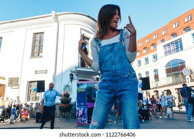 June 9, 2018 , Minsk,Belarus Street walks A woman with microphones stand on the street