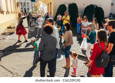 June 9, 2018 , Minsk,Belarus Street walks A woman launches soap bubbles in front of a group of people