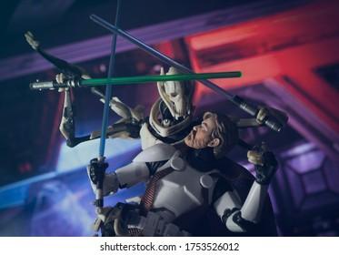 JUNE 9 2020: Recreation of a scene from Star Wars The Clone Wars with Obi Wan Kenobi battling Separatist General Grievous - Hasbro action figures