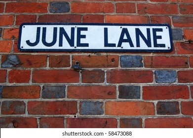 June Lane road sign An enamel road sign for June Lane in Midhurst, West Sussex.