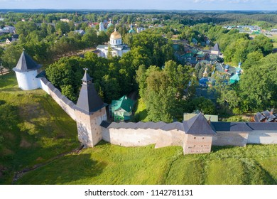 A June morning at the walls of the Holy Dormition Pskovo-Pechersky Monastery (aerial survey). Pechory, Russia