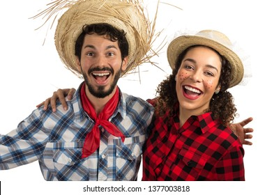 June Party or Festa Junina in Brazil. Beautiful couple is smiling very happy and looking at the camera. Concept of fun and joy.