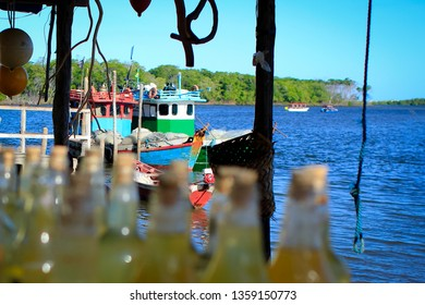 June/2015. Boats moored on a small pier in a riverine community in the metropolitan region of São Luís do Maranhão, northeastern Brazil.
