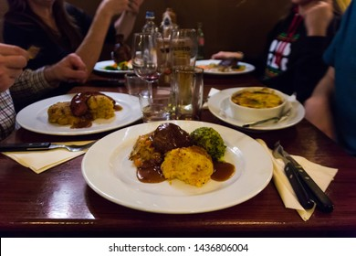 June2019. Traditional dutch food at the Pantry Restaurant (Amsterdam, Netherlands). Close up of a delicious meal : Hutspot with a meatball and gravy (mashed potatoes mixed with stewed beef, carrots)