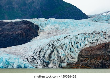 Juneau, AK, USA - May 25, 2016:  View of the moraine and blue ice of the Mendenhall Glacier.