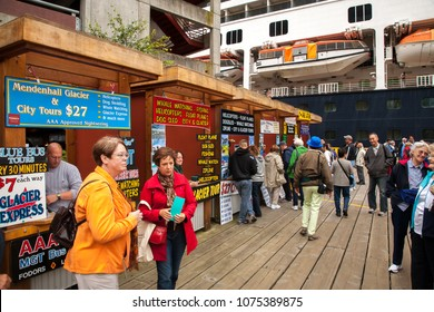Juneau, Alaska, USA - 8/20/2010:  Tourist operators, hawkers, in Juneau are selling tour packages to tourist that just got off a cruise ship.