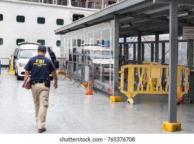 Juneau, Alaska, USA - July 26th 2017: FBI officers from the Evidence Response Team are going inside the Emerald Princess Cruise Ship docked in Juneau to investigate a crime.