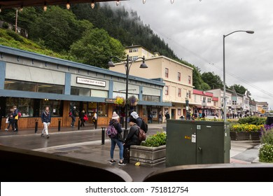 Juneau, Alaska, USA - July 28th, 2017: View behind the wooden swinging doors of the The Red Dog Saloon in Juneau.